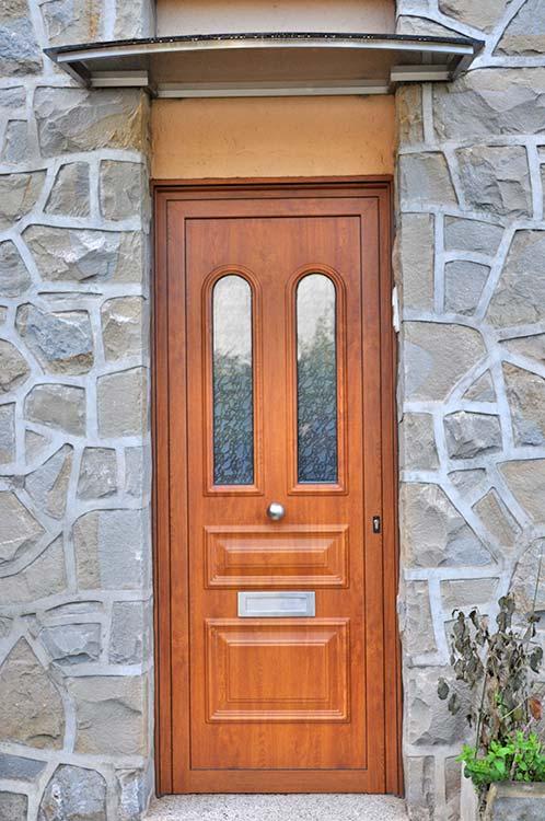Puerta de entrada de aluminio imitación madera